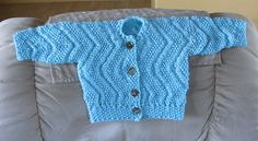 Reversible Ripples Baby Sweater - free pattern on Ravelry