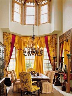 dining room with yellow and red draperies over custom shades, in a bay window. Design by? Please let me know if this is your design. Cool Curtains, Colorful Curtains, Curtains With Blinds, Corner Window Treatments, Custom Window Treatments, Southern Living Rooms, Elegant Dining Room, French Country Decorating, Decoration