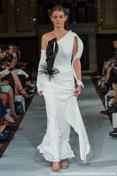 Lenie Boya London Fashion Week S/S 2015. White futuristic dress with 3D Black calla lily detail, and 3D Arm bracelet.