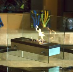 """Italian for """"fiery passion"""", this elegant fireplace lives up to its name. A large capacity stainless steel burner is capped with a sleek black cover drawing attention to the dancing flames. The burner"""