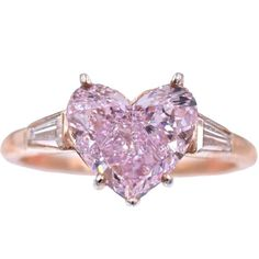 For Sale on - NALLY Fancy Purple- Pink Diamond Ring. The diamond is set in a Cartier Mounting with 2 Tapered Baguette Cut Diamonds, with an approximately total Heart Shaped Diamond Ring, Heart Shaped Engagement Rings, Pink Diamond Ring, Diamond Rings For Sale, Heart Shaped Rings, Diamond Studs, Diamond Engagement Rings, Solitaire Rings, Pink Diamonds
