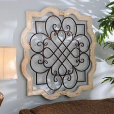 Wood Isabelline Plaque- Item #: 112960 $79.99- A beautifully understated piece of ornamental wall art, this wood plaque features scroll accents and a cream finish. Plaque measures 37L x 37H in. Crafted of metal and wood composite distressed cream finish. Features a scrolled metal centerpiece in dark bronze. Comes ready for wall mount
