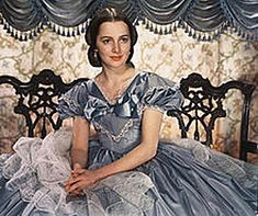 Olivia de Havilland as Melanie Wilkes in Gone with the Wind. Costume briefly seen during Scarlett O' Hara's wedding to Charles Hamilton. Margaret Mitchell, Scarlett O'hara, Olivia De Havilland, Vivien Leigh, Golden Age Of Hollywood, Vintage Hollywood, Classic Hollywood, Wind Movie, Rhett Butler