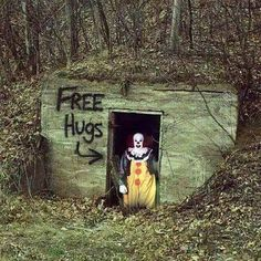Free hugs. freaky clown. I would be giving out free bullets after seeing this. !