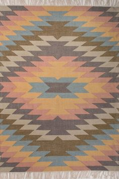 This indoor outdoor flat weave is inspired by the traditional kilims of the desert region, with both warm and bright colors.