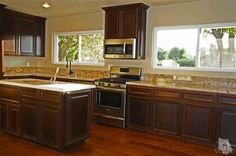 Spacious island kitchen has new granite countertops, new cabinetry and new stainless steel appliances.