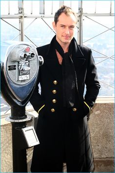 November 2016: Jude Law wears a Saint Laurent military-style coat to ceremoniously light the Empire State Building in New York City.