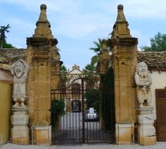 Grinning dwarfs welcome visitors to Villa Palagonia, Bagheria, Sicily.