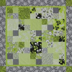 Four-Patch blocks and setting squares from fat quarters team up for a fabulous table topper.