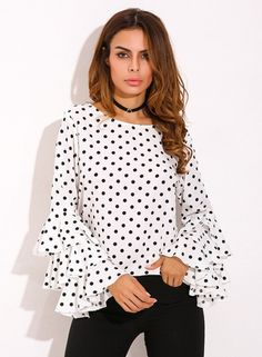 The blouse is featuring round neck, flounce sleeve, polka dot.