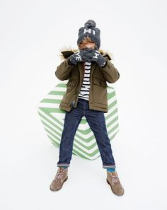 J.Crew kids' Nordic parka, boys' long-sleeve classic-striped T-shirt, jersey-lined slim cord, hi bye beanie, hi bye gloves, shearling MacAlister boots and glow-in-the-dark MacAlister laces.