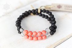 This stretch Lava rock bracelet with pink coral, crystal quartz and silver is great for daily wear. It provides protective and grounding effect, also increases awareness and clarity by calming the mind. Give a gift with Intention for yourself or someone you care about.  DETAILS: • Length: 6 to 8 (15 - 20.5cm) | Width: 6mm. • Natural lava rock, pink coral (dyed) and crystal quartz; 925 sterling silver; • All beads are strung on a strong stretch cord, to adjust your wrist size. •…