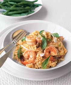 Chili Shrimp and Coconut Risotto|This easy version of risotto—flavored with chili paste and coconut milk—takes just a few minutes to make and doesn't require constant stirring.