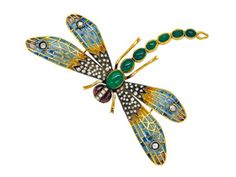 A Multi-Gem and Enamel Dragonfly Brooch with Plique-a-jour wings accented by rose-cut diamonds, with an articulated cabochon emerald tail. 18k gold and silver.