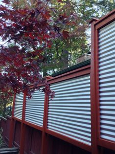 New corrugated metal fence for privacy screen between houses. I love the clean, minimalist look.