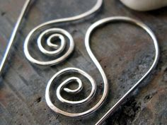 Modern sterling silver spiral handcrafted earrings. Artisan sculpted wirework. Urban lightweight everyday jewelry. 20 gauge wire. Electra.. $25.00, via Etsy.
