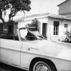 Brigitte Bardot poses in a Renault Floride, 1959
