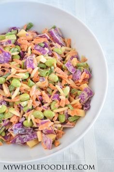 Easy Cabbage Salad with a tahini dressing.  Eat it on it's own, or add your favorite protein.  It would be great with rice or quinoa too. #vegan #glutenfree #salads