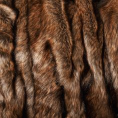 Warm, luxurious comfort is yours with a faux coyote fur throw Throw blanket is perfect to cuddle up with on chilly evenings Bedding is at home in the bedroom or thrown on a couch or chair Measures 60