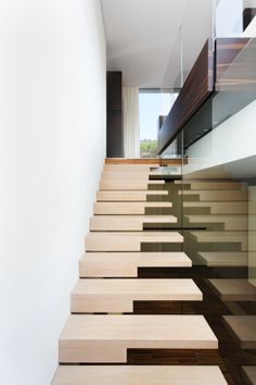 Villa in den Weinbergen | Lee + Mir. Since I play piano, this would be cool to have a piano staircase.
