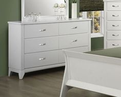 The Eleanor Collection Dresser by Coaster Home Furnishings. $447.35. Sleek metal hardware pulls. Contemporary. Wood Veneers Solids. The Eleanor bedroom group is in a league of its own with minimalist elegant curved side rails and sleek headboard and footboard. Features sharp clean edges on the case pieces, drawers are constructed with dovetail sides and smooth metal on metal glides. The collection is featured in smooth white finish.. Save 58% Off!