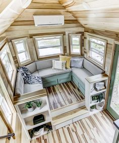 Inside the 240-square-foot house are colorful poplar walls and ceiling with vinyl floors. The spacious living room is set on a platform with hidden storage underneath