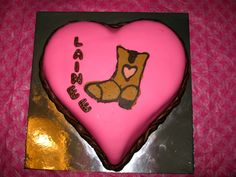 Heart shaped cake with chocolate and peanut butter boot.