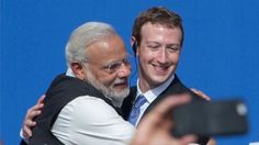 Indian Prime Minister Narendra Modi (L) and Facebook CEO Mark Zuckerberg hug after a Townhall meeting, at Facebook headquarters in Menlo Park, California, on September 27, 2015.