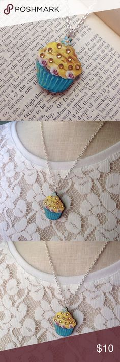 "Adorable wooden cupcake necklace with rhinestones This little cut cupcake necklace is made from laser cut wood. I added some rhinestones to the frosting to give it some sparkle!✨ Necklace chain is 18"". If you prefer a different length let me know and I'll adjust it for you. Nickel & lead free. Handmade by me & brand new! Bundle & save 15% on 3+ items. Tags:Vintage,Retro,Pinup,Kawaii,Rockabilly,Shabby Chic,Kitsch,Summer✨ Abbie's Anchor Jewelry Necklaces"
