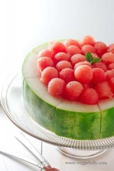 Watermelon Cake  Instead of cutting up your watermelon and serving on a platter in triangular chunks, get creative and carve out this cake topped with little watermelon balls