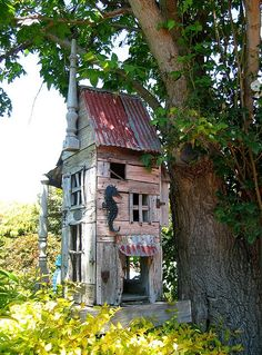 "scraps and finds..in design..a backyard home for birds, and squirrels. "".overdone fun"""