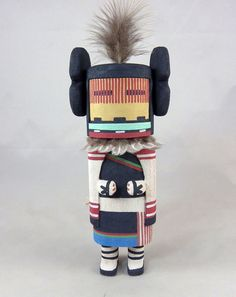 Kachin' mana is the Kachina girl who is the wife of the Kachinas. She also represents the young girls who grind corn.