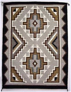 Example of a Two Grey Hills style rug. (Begun by George Bloomfield and Ed Davies, 1920s. Tweaked from Crystal style. Known for: Craftsmanship, Fineness of the weft, outer border and interior borders, being symmetrical, no two rugs are identical.