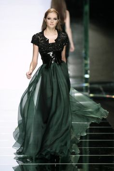 WOW...Dark green dress and black.... Art... Beautiful Flow... Beautiful Design... Kind of a belted corset look in the middle...
