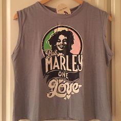 """Music Icon Bon Marley """"One Love"""" T-Shirt Get ready to party Bob Marley style! Fall in love this summer! Combine this cute T-Shirt with one of the low rise shorts and receive a 5% bundle discount! Definitely a beach ready outfit! Tops Crop Tops"""