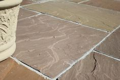 Raj Green Sandstone Paving is often referred to as 'Indian Yorkstone' due to its resemblance to traditional British Yorkstone paving. It is a cost effective alternative to the 'real deal' for gardens where budget is a concern.