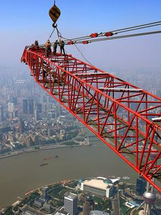 Eddie Bell saved to Cool vertigo-inducing images show construction workers on the billion structure as they dismantle cranes. Crane Construction, Heavy Construction Equipment, Heavy Equipment, Shanghai Tower, Marine Engineering, Naval, Heavy Machinery, Image Shows, Skyscraper