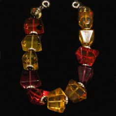 Unsigned French 1970's Lucite and Rhinestone Architectural Bead Necklace.   18 in. Very chic faceted lucite cubes of purple, amber and red beads with rhinestone spacers and classic French closure.   #mdvii #1970s #catalog #lucite #necklace #vintage