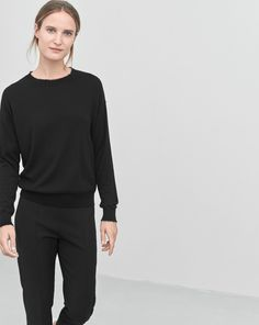 Classic style in soft luxurious wool-silk cashmere blend. Frayed neck and cuff detail.  <br><br> - Luxurious fine knit <br> - Classic fit <br> - Frayed neck and cuff <br><br> The model is 177cm and wears size S.