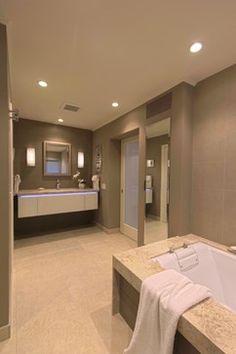 Master bath retreat design with floating vanity & mirrored tall storage. www.kitchendesignbyjoanne.com