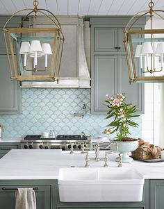 Beautiful kitchen...scalloped backsplash tile, cabinet color, lighting and farmhouse sink
