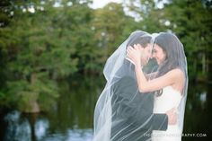 Couple wrapped in brides veil