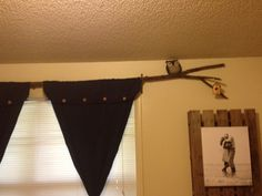Rustic tree branch curtain rod with owl and treehouse