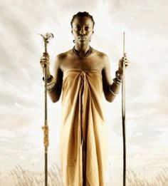 Kikuyu Woman with Traditional symbols of power -Muthigi (stick)signifying power to lead and Itimu (Spear)-power to call people to war*Before the overthrow of Wangu wa Makeri women could carry both.