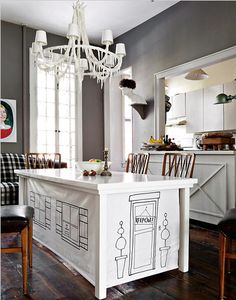Roller shades attached to the underside of the table pull down to transform the table into a magical fort!