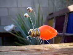 CRAFT - for the older kids Light-ning bug!Enlightment Bug ~ Inspiration photo (even smaller lightbulbs can be found at most Dollar Stores)Light-ni get bug cute!Little bug made from discarded X-mas light, wire, metal beads. by tommie Garden Crafts, Garden Art, Crafts To Make, Crafts For Kids, Light Bulb Crafts, Ideias Diy, Junk Art, Wire Crafts, Recycled Crafts