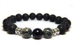 About the Bracelet A bold look with stones of strength. This large beaded mens gemstone bracelet is worn for strength and positivity. Bracelet Details: This mens bracelet is made with: - 10mm Black On