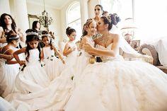 Sweet wedding photo of the bride and flower girls by Florida based JSP Studio | via junebugweddings.com