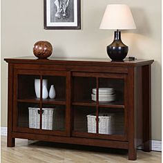 Update your home furnishings with this sliding door buffet. This buffet features a beautiful walnut cherry finish and a glass sliding door for various display items.