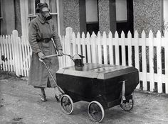 Woman walks with a Gas-Resistant Pram, England, (1938)